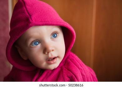 portrait of amazed beautiful child in stripe cap