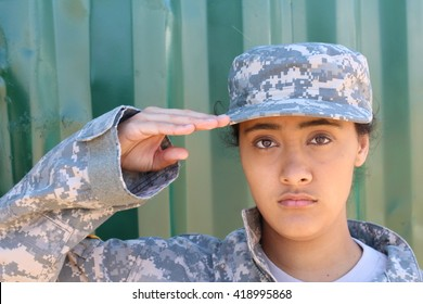 portrait of american female soldier saluting