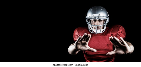 Portrait of American football player defending against black