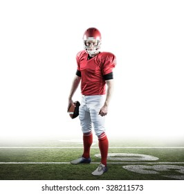 Portrait of american football player holding football against american football pitch