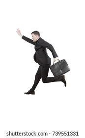 Portrait of an American manager carrying a briefcase while running in the studio