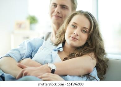 Portrait of amorous young couple enjoying rest
