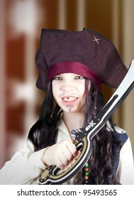 Portrait of an angry boy dressed like a medieval pirate