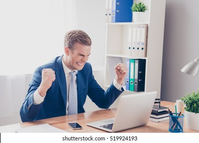 Portrait of angry businessman in bad mood showing fists