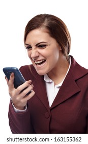 Portrait of angry businesswoman holding a cell phone and screaming into it, isolated on white background