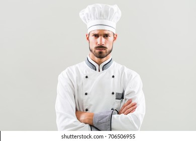 Portrait of angry chef on gray background.Furious chef