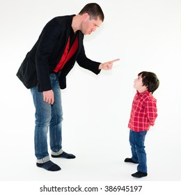portrait of angry father scolding his son pointing finger, isolated on white background