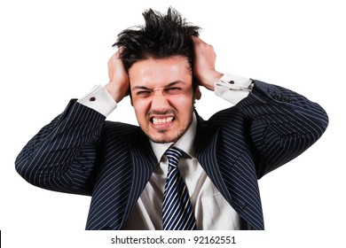 portrait of angry and frustrated businessman pulling his hair