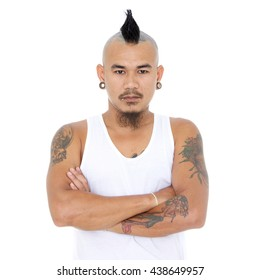 portrait of angry, mad asian punk guy with mohawk hair style, piercing and tattoo in white top tank isolated on a white background