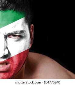 Portrait of angry man with painted flag of Italy