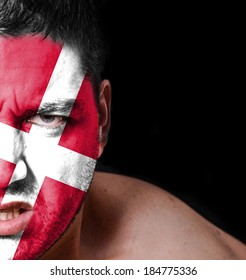 Portrait of angry man with painted flag of Denmark