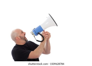 Portrait of angry man shouting with a megaphone. Bearded man yelling into a megaphone, isolated. Copy space for your text