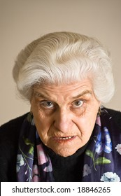 Portrait of an angry mature woman, looking to the camera.