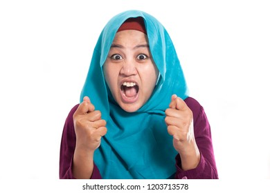 Portrait of angry muslim businesswoman wearing hijab mad insanity gesture