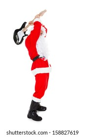 Portrait of a angry santa breaking guitar over white background