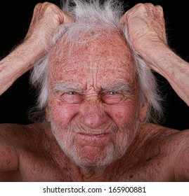 Portrait of an Angry Senior Man on black background