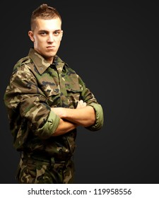 Portrait Of Angry Soldier against a black background