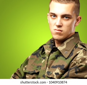 Portrait Of Angry Soldier against a green background