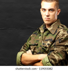 Portrait Of Angry Soldier against a grunge background
