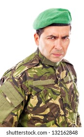 Portrait of an angry soldier with green beret  against white background
