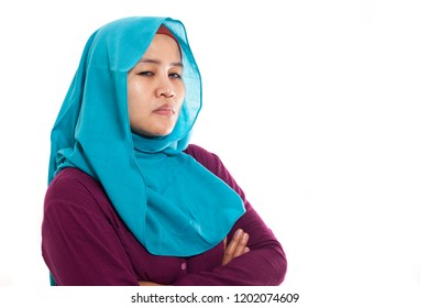 Portrait of angry sullen unhappy cynical muslim woman businesswoman with crossed arms isolated on white