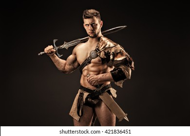 Portrait of angry warrior in leather clothes with swords
