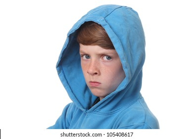 Portrait of an angry young boy on white background