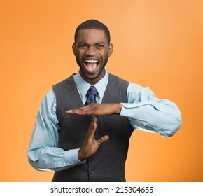 Portrait angry young business man showing time out gesture with hands, screaming to stop isolated orange background. Negative human emotions, facial expressions, sign, symbols, body language, attitude