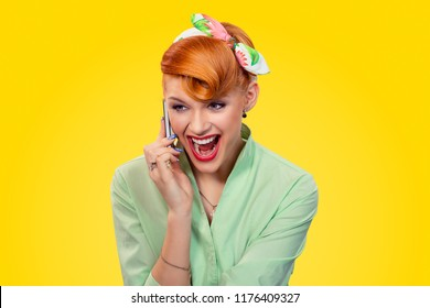Portrait angry young woman pinup girl screaming on mobile phone isolated yellow background retro vintage 50's style. Human emotions body language. Negative human emotions feelings