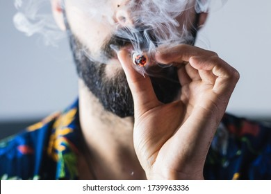 Portrait of anonymous man smoking weed
