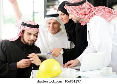 Portrait of araabic architect explaining his project