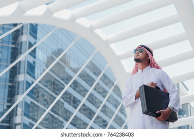 Portrait of Arab business man buiding town background