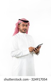 Portrait of Arab businessman using digital tablet