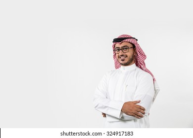 Portrait of Arab man with arms crossed