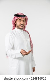 Portrait of Arab man with cupped hand