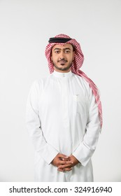 Portrait of Arab man with hands clasped