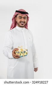 Portrait of Arab man holding gift box