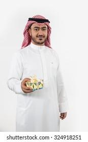 Portrait of Arab man holding gift box