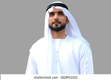 Portrait of an Arab man wearing kandora dish dash on gray isolated copy space background