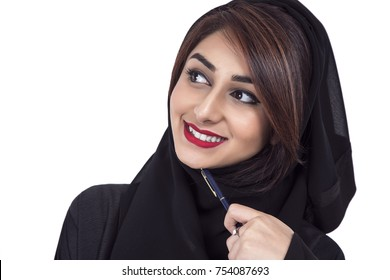 Portrait of a Arab young smiling woman holding a pen and thinking