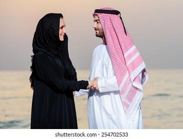 Portrait of Arabic dressed yang couple on sanset.
