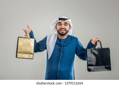 Portrait of arabic man with kandora in a studio