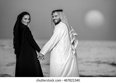 Portrait of Arabic way dressed yang couple.