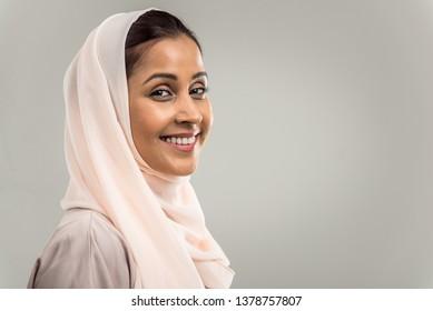Portrait of arabic woman with abaya dress in a studio