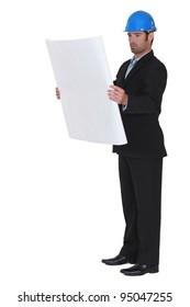 Portrait of an architect reading plans