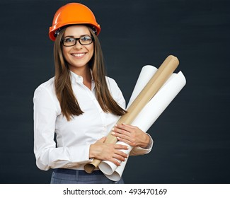 Portrait of architect  student woman with blueprints protect helmet wearing. Black background.