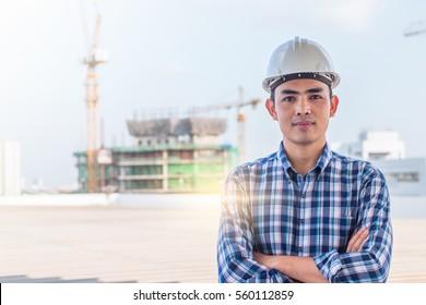 Portrait of architect wear white helmet safty on construction site with crane background