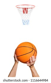portrait of the arms of a basketball player intent on shooting the basket