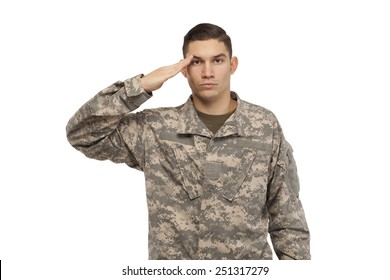 Portrait of army soldier saluting against white background