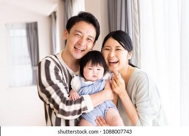 portrait of asain family in living room